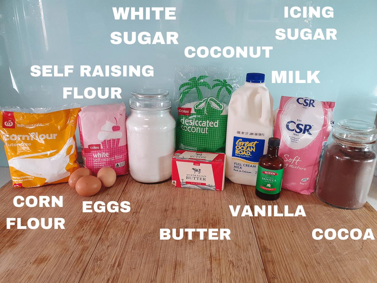 Lamington ingredients, corn flour, eggs, self raising flour, white sugar, butter, coconut, milk, vanilla, icing sugar, cocoa.