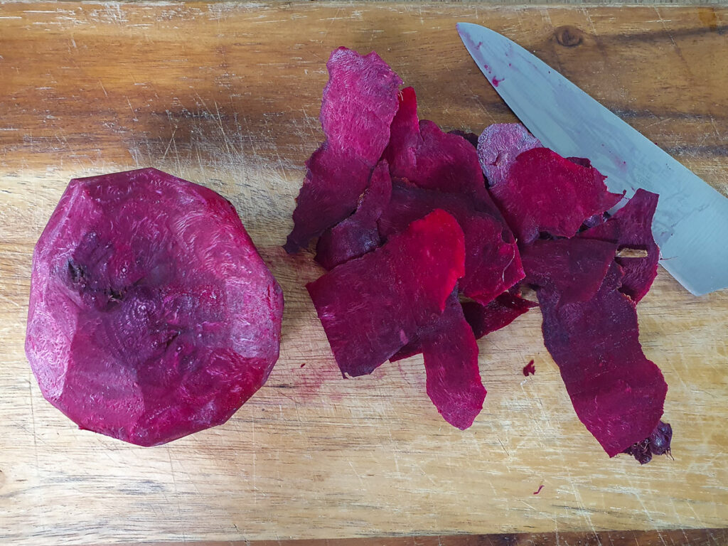Peeling beets with a sharp knife