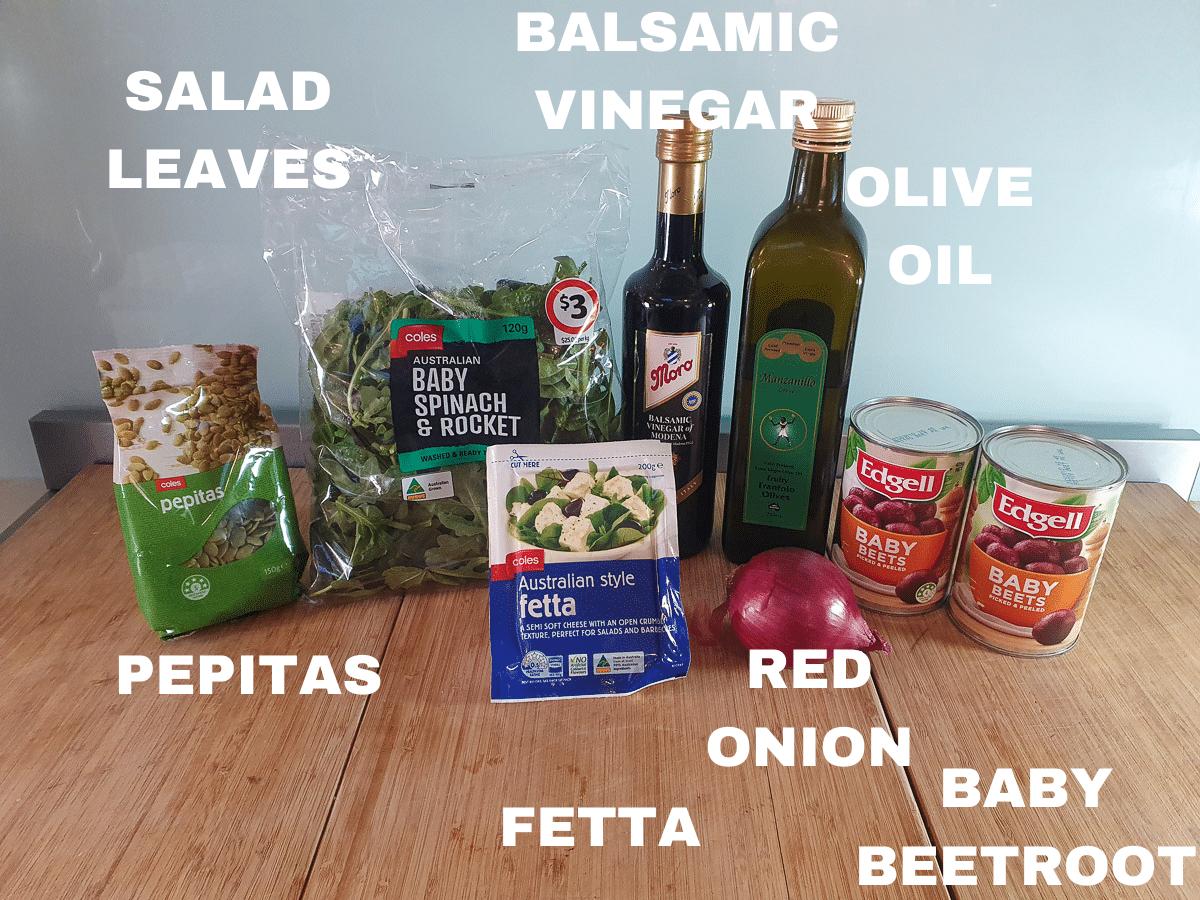 Beetroot salad ingredients, pepitas, salad leaves, fetta cheese, red onion, tinned baby beetroot, balsamic vinegar, olive oil.
