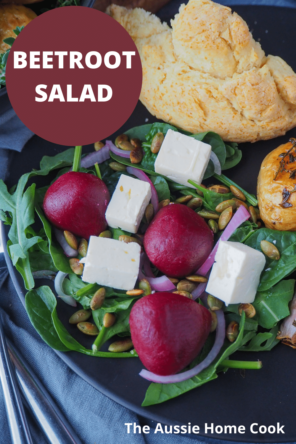 Beetroot salad on a plate, with damper and roasted mini potatoes on the side, with text overlay, beetroot salad, The Aussie Home Cook.