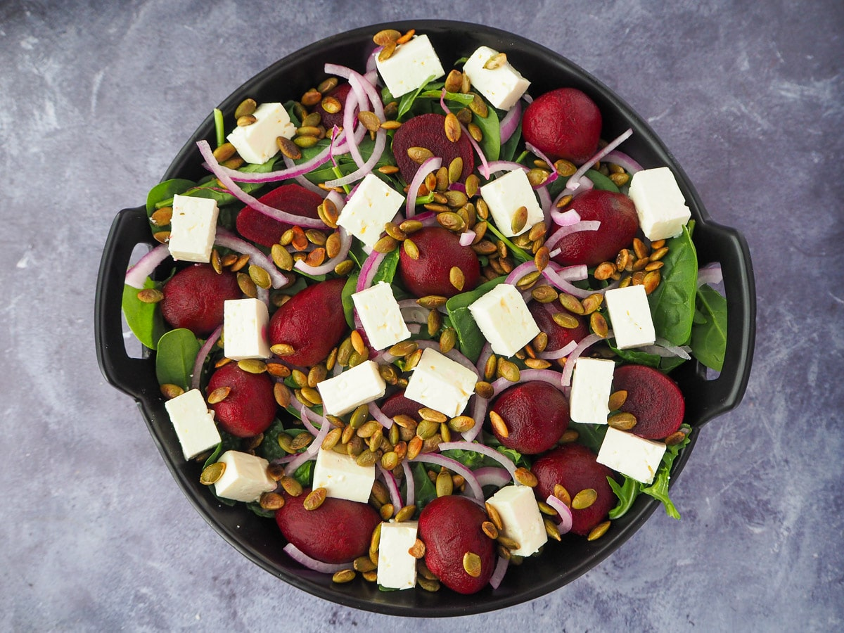 Salad with roasted pepitas sprinkled over the top.