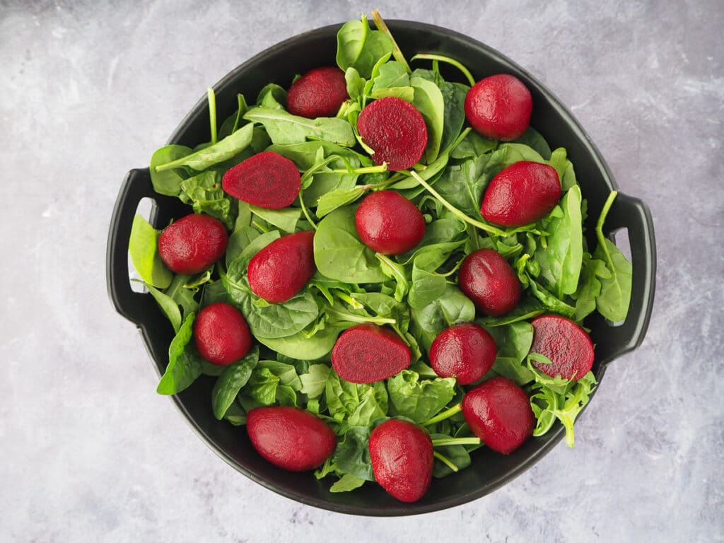 Adding beetroot to the salad.