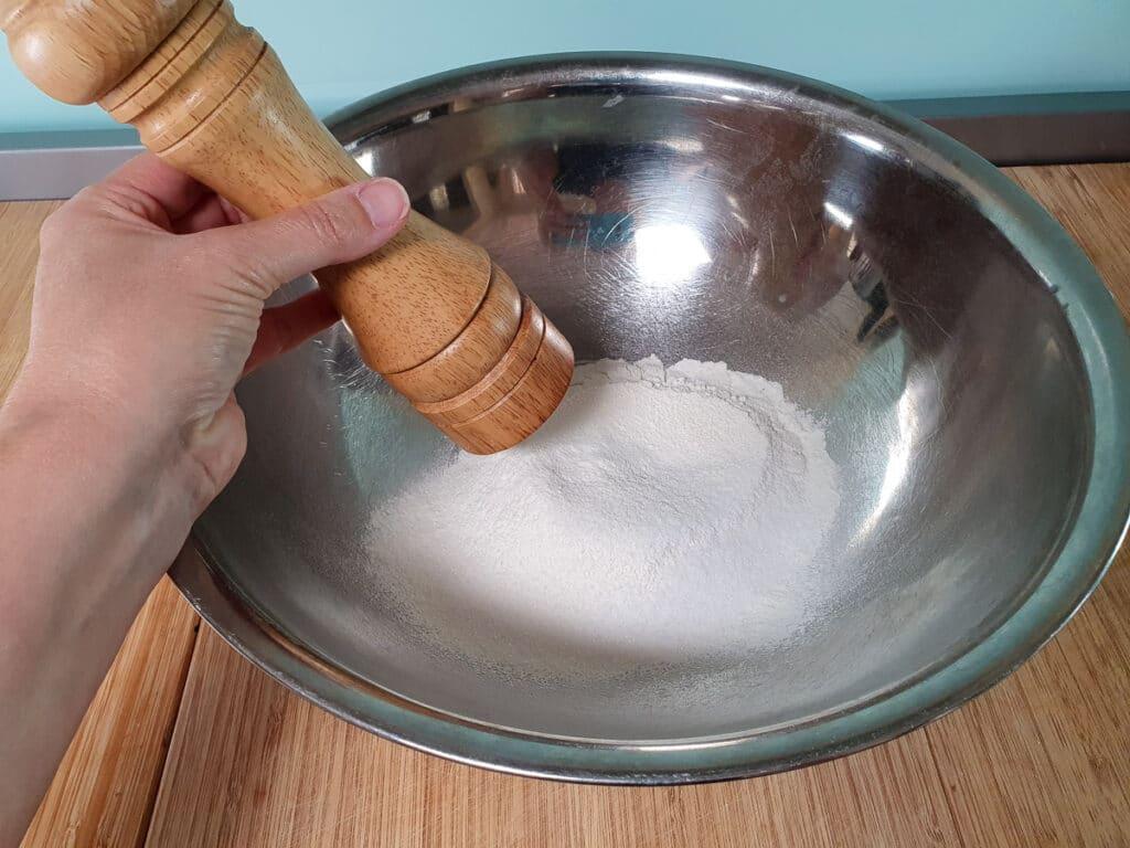 Adding salt to dry ingredients.