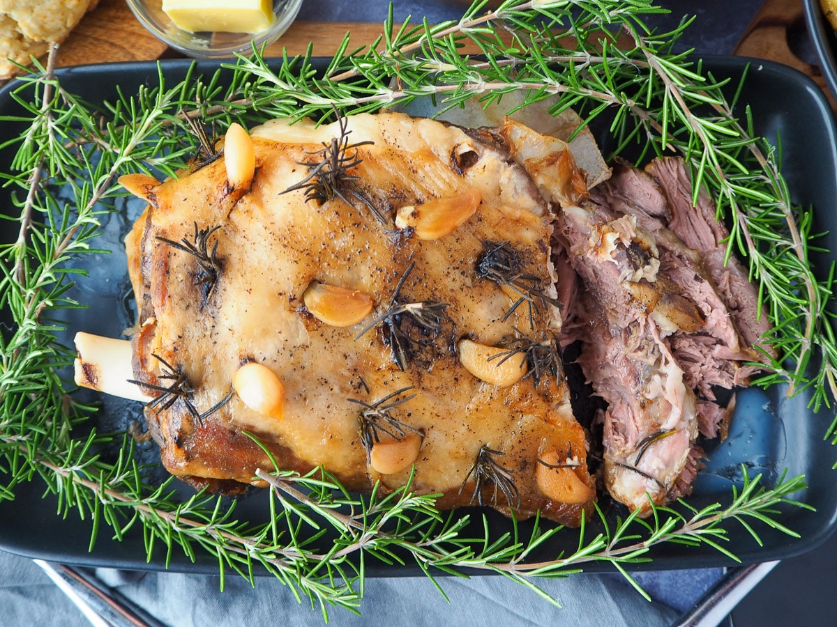 Slow cooker lamb roast on a serving plate.