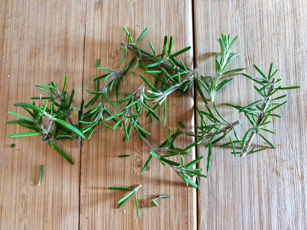Short sprigs of chopped rosemary, about ¾ inch ish long, ready to insert into lamb.