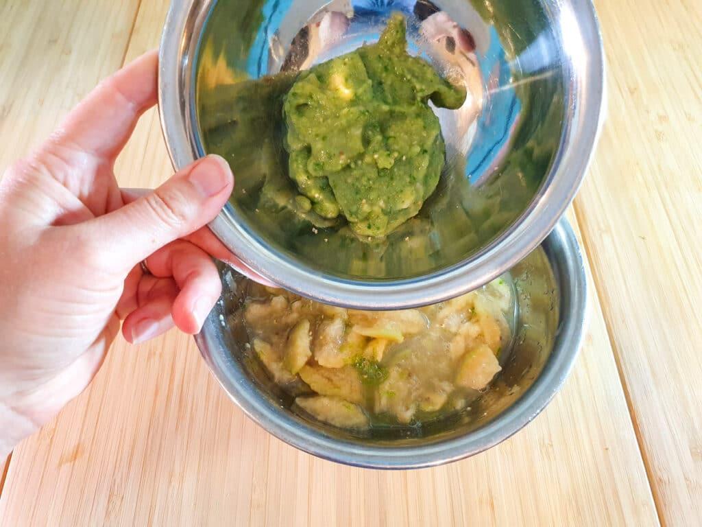 Adding whole blitzed feijoa to mashed feijoa pulp.