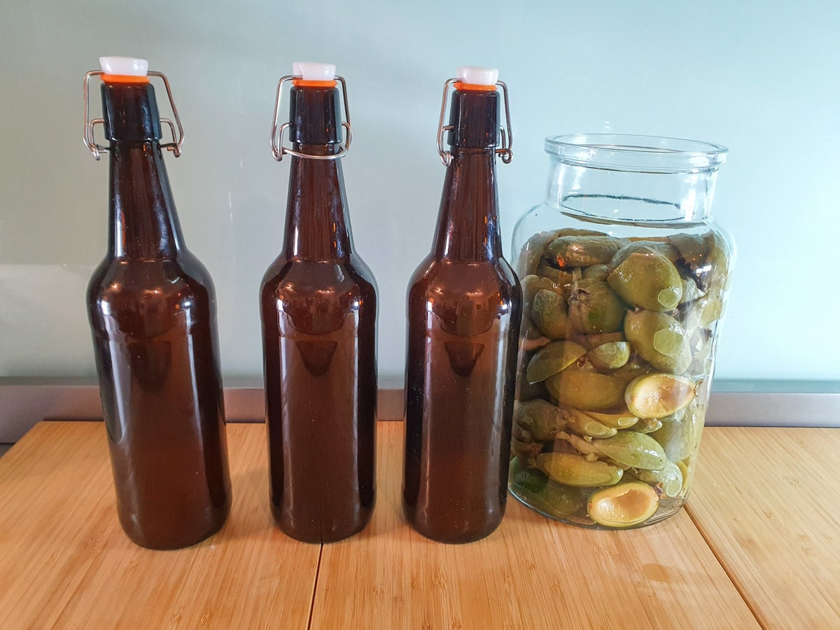 Bottles filled with feijoa juice ready for second brew.