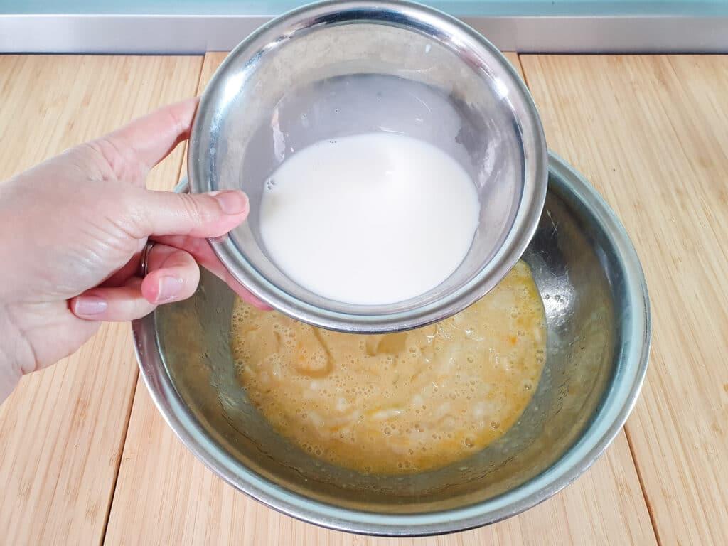 Adding milk to mashed feijoas.