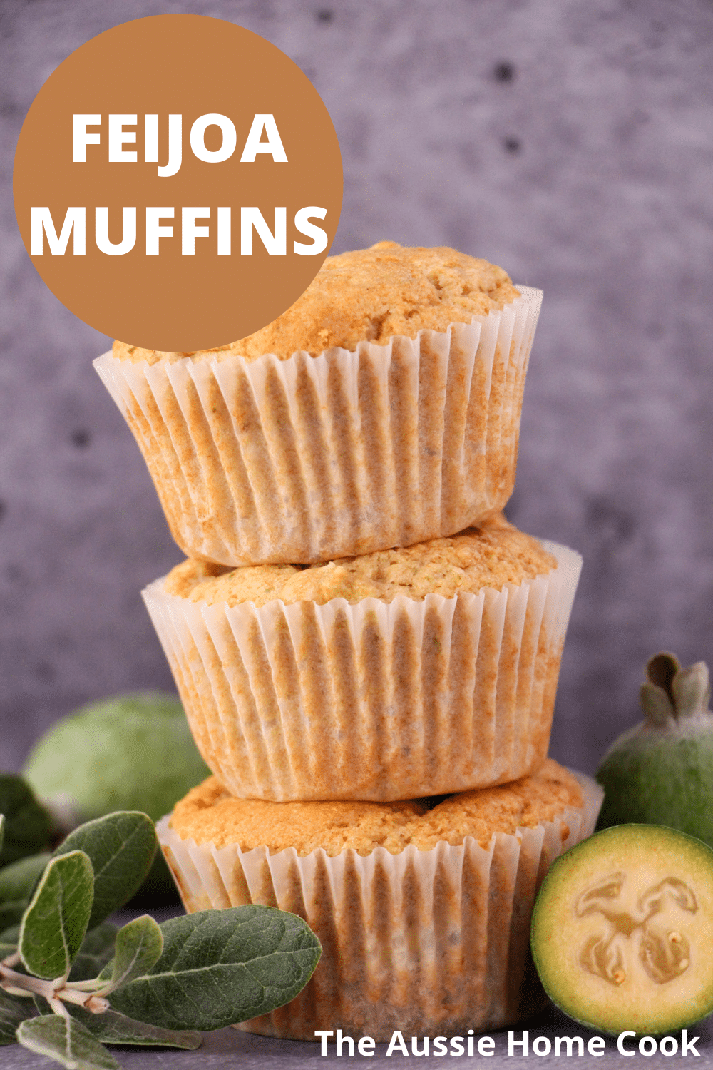 Stack of three feijoa muffins, with fresh feijoas and feijoa leaves and text overlay, feijoa muffins, the aussie home cook.
