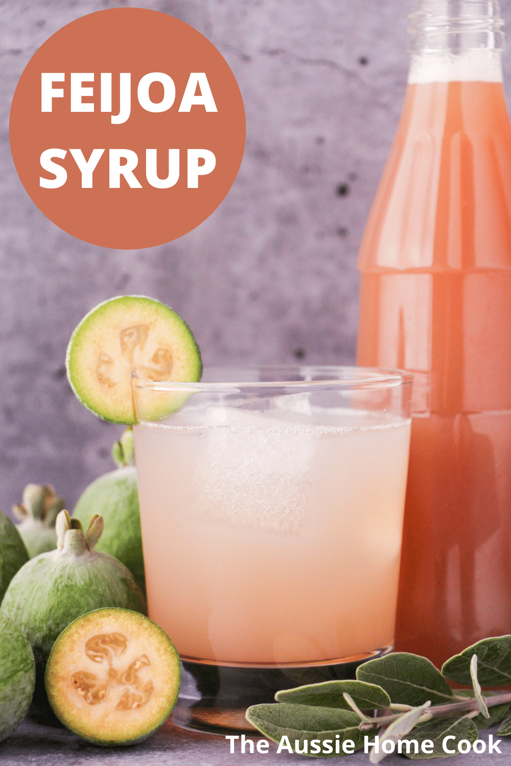 Glass of made up feijoa syrup with ice and fresh feijoa garnish, with bottle of feijoa syrup and fresh feijoas and leaves, with text overlay, feijoa syrup and The Aussie Home Cook.