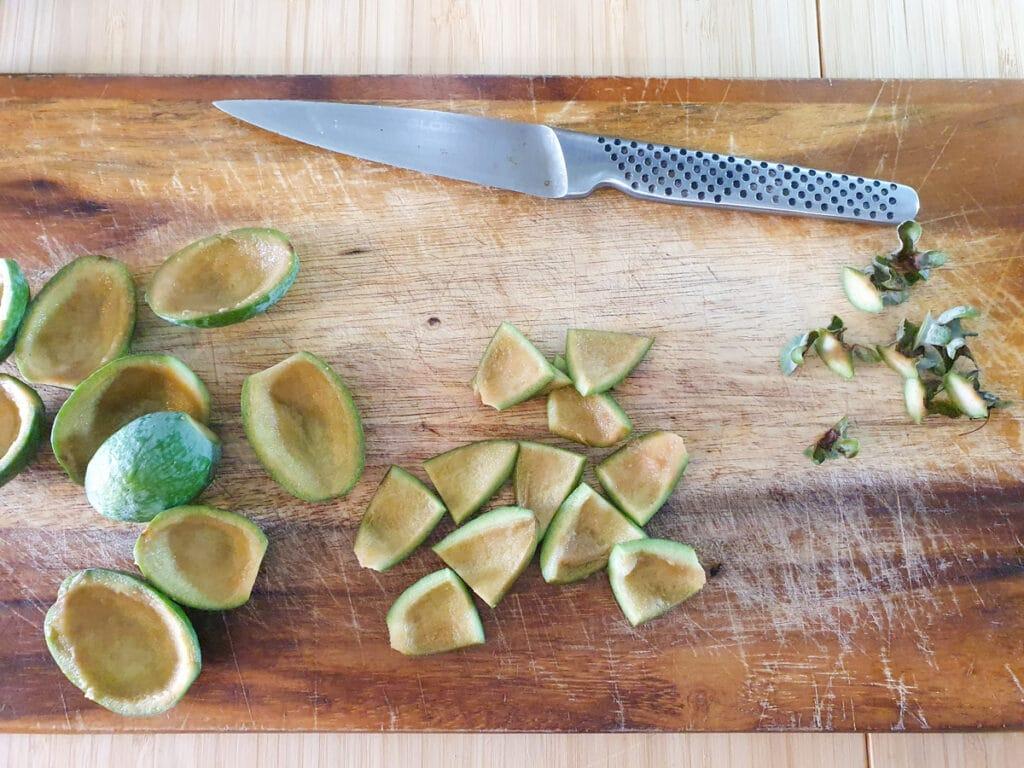 Slicing up feijoa skins.