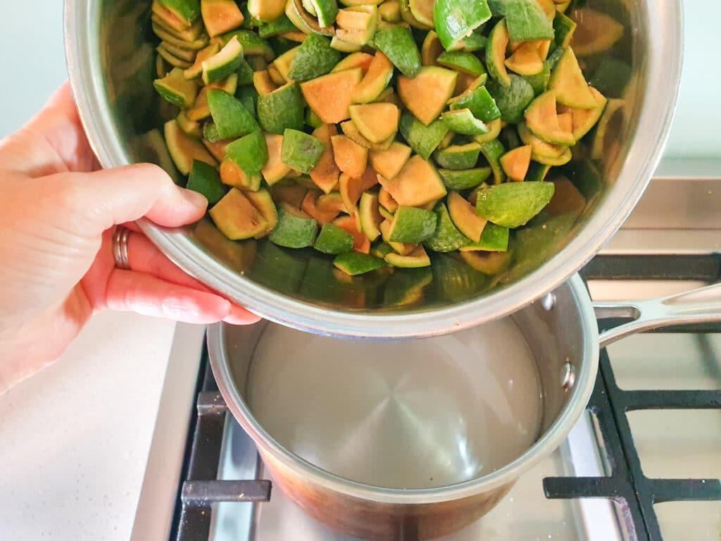 Adding chopped feijoa skins to pot.