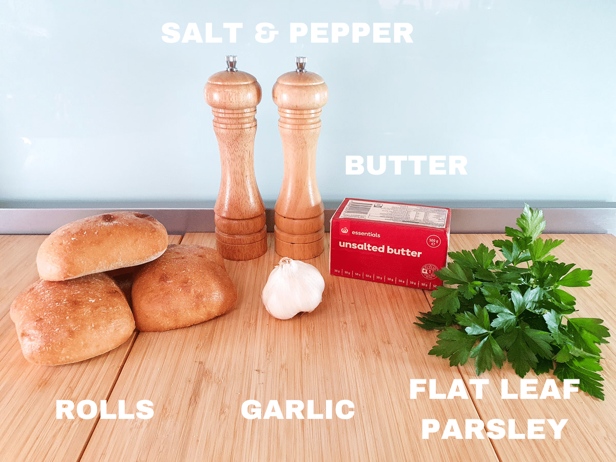 Air fryer garlic bread ingredients, rolls, salt and pepper, garlic cloves, unsalted butter, flat leaf parsley.