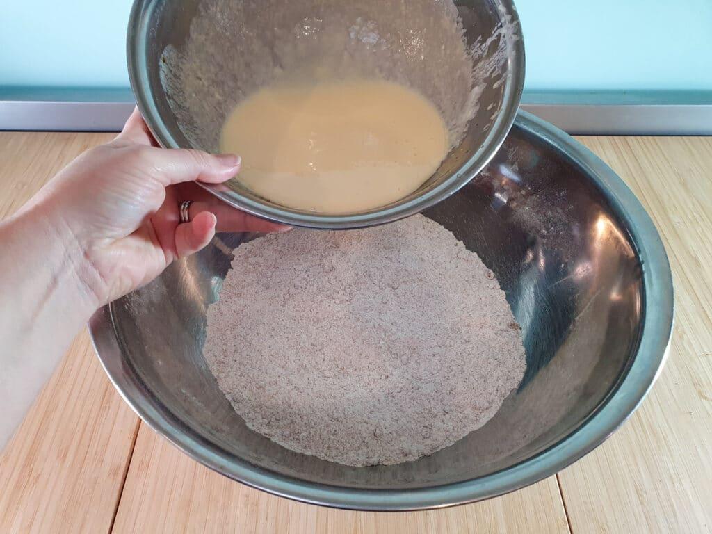 Adding milk mix to dry ingredients.