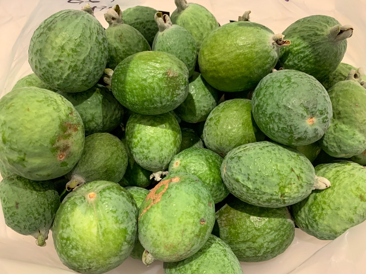 Large pile of feijoas.