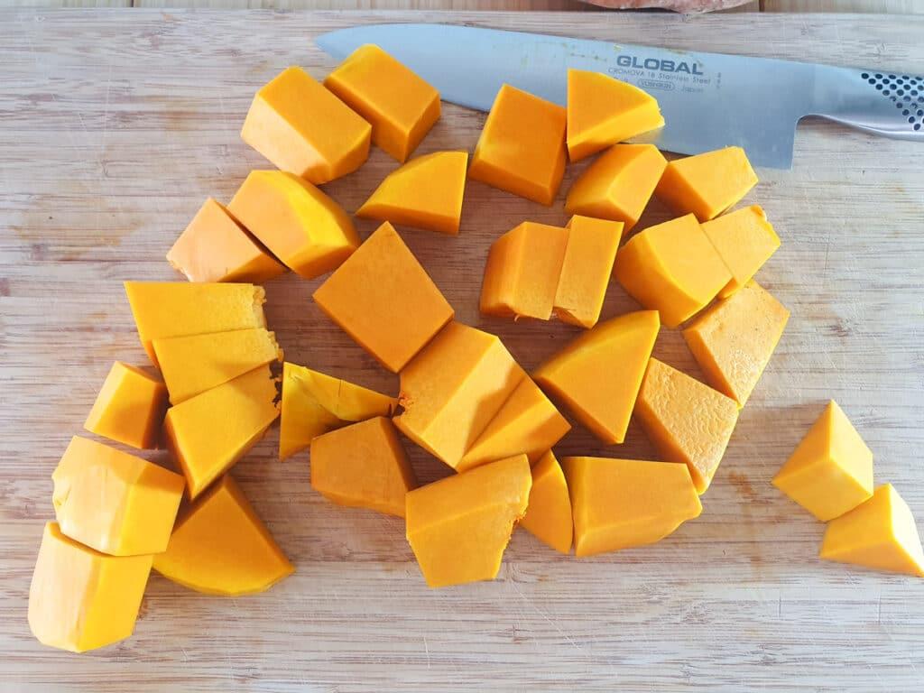 Chopping the peeled pumpkin in to medium sized chunks.